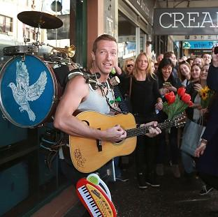 This Is Local London: Coldplay's Chris Martin serenades the crowd on the streets of Sydney (Rex)
