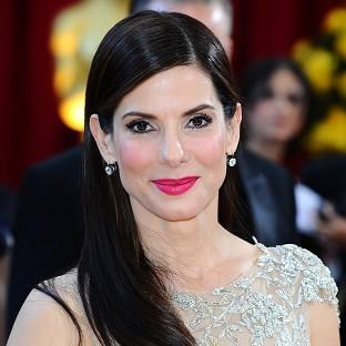 A man accused of breaking into Sandra Bullock's home is also facing a raft of weapons charg