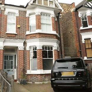 This Is Local London: The front of former footballer Ian Wright's house in London, where his wife and children were burgled at knifepoint.