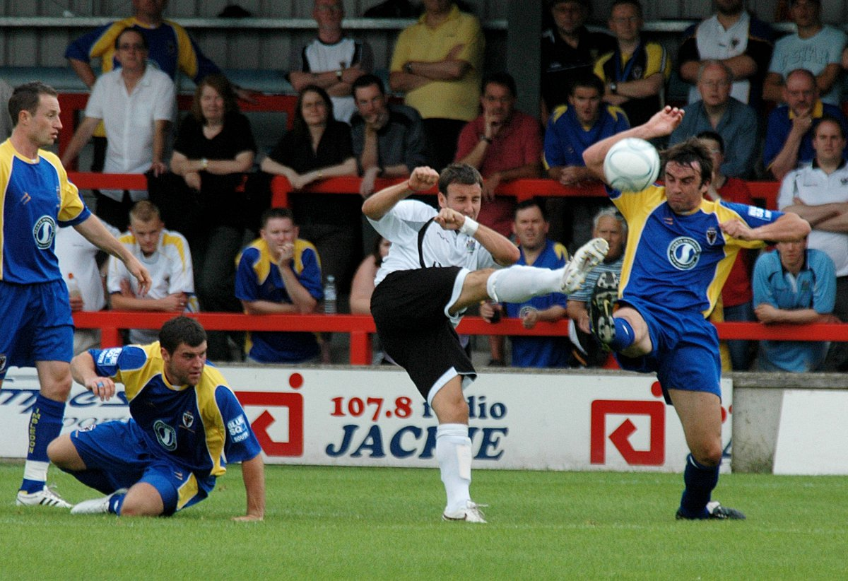 Putting the boot in: Kingstonian's former AFC Wimbledon defender Alan Inns in action at Kingsmeadow
