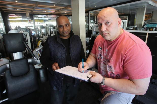 Gym owner Dean Hyams signs Suja Khaled's petition against the E11 (BID) company.