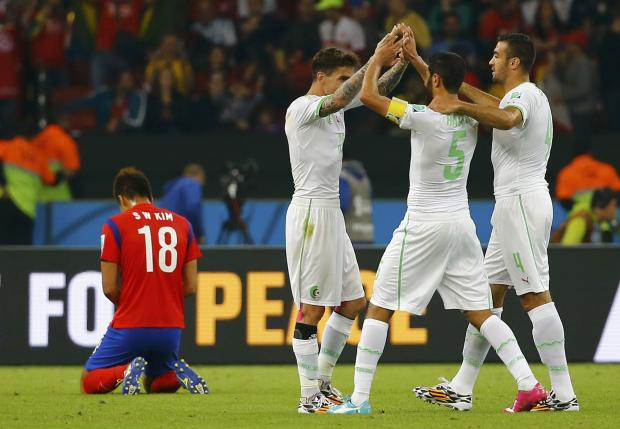 Essaid Belkalem (right) celebrates Algeria's victory with his teammates. Picture: Action Images