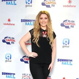 Ella Henderson remains top of the UK singles chart with her song Ghosts
