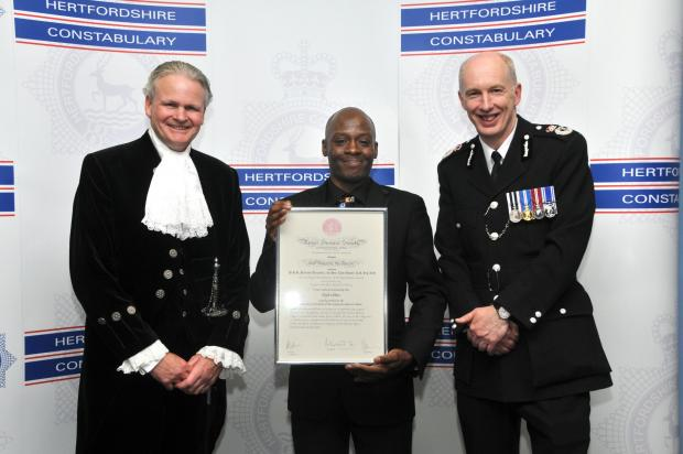 Elijah White, centre, with the police officers from Hertfordshire Constabulary