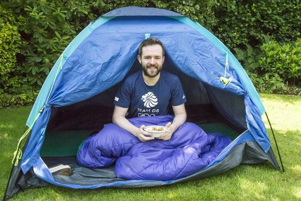 Christopher Roche gets ready for another night in his tent