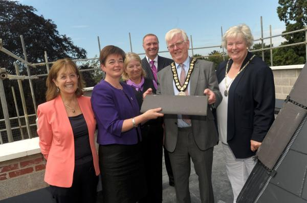 Topping out: Sonia Hamilton-Martin, Jane Ashcroft, Sarah Clarke and Tim Seal with the mayor and mayoress of Elmbridge