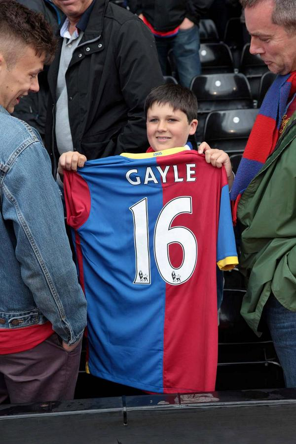Prized possession: Freddy Gill proudly shows off the shirt worn by Dwight Gayle during the 2-2 draw at Craven Cottage