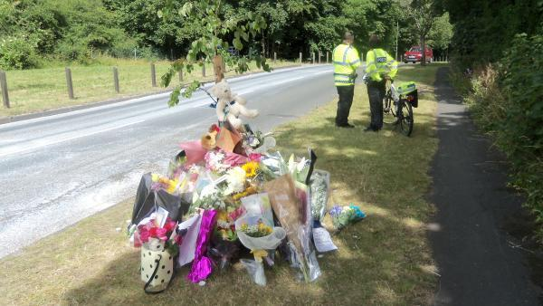 Tributes left round a tree by the side of Banstead Road