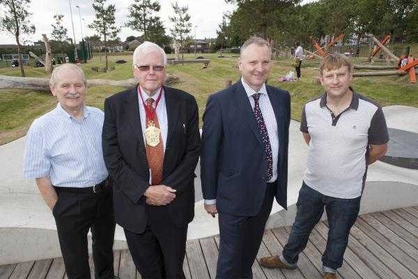 Council Leader Chris Robbins, Mayor of Waltham Forest Councillor Terry Wheeler, Chief Executive Martin Esom, and Deputy Leader and Cabinet Member for Environment Councillor Clyde Loakes (from left to right) at Drapers Field.