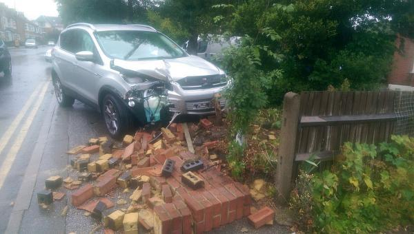 This Is Local London: The Ford Kuga ended up in someone's front garden (image by Martin Peaple).
