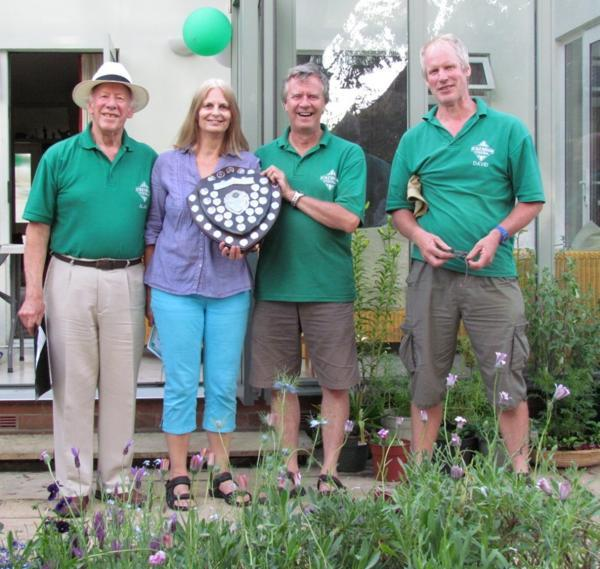 Honoured: Rose and Doug (centre) receive the shield from Alan Noad (left) and David Edington, of Ickenham Festival