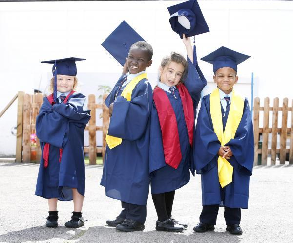 John Keats pupils: Megan, David, Ariana, all five and TJ aged four, celebrate their first year