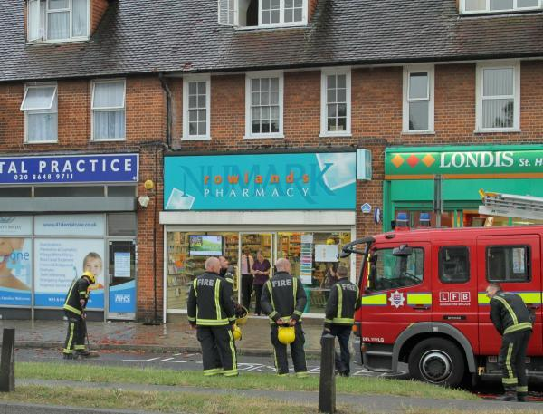 Firefighters at the scene of the lightning strike in Morden today. Picture: Claire Armstrong.