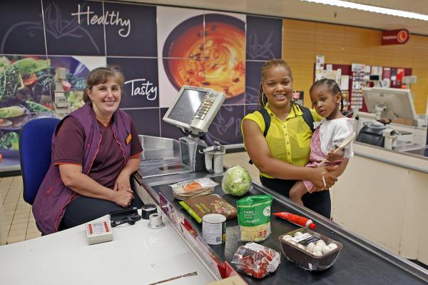 Rashida Boateng with daughter Bailey and Sainsbury's worker Eka Chirgadze at Sainsbury's in High Street, Walthamstow