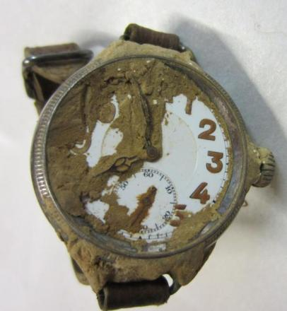 The watch of Lieutenant Twite still covered in mud from the Somme