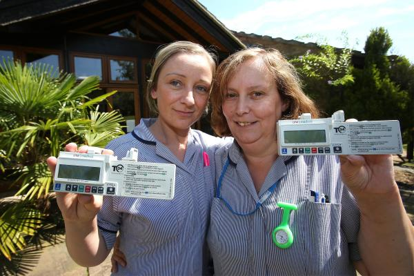 Nurses Tracy Davies and Ann Dalgliesh with syringes funded by the Gannett Foundation donation.