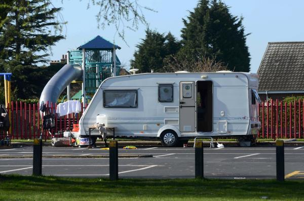 Caravans: Travellers also set up camp at Hersham Recreation Ground in April 2013