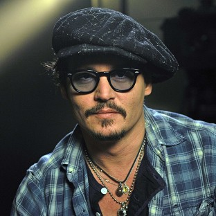 Johnny Depp plays guitar on the track Kansas City, featuring lyrics by Bob Dylan