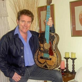 The guitar is signed by the likes of The Beatles, Buddy Holly and The Rolling Stones
