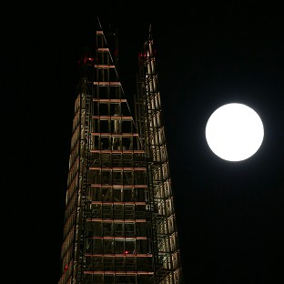 This Is Local London: A view of the 'supermoon', or perigee moon, rising behind The Shard building in London.