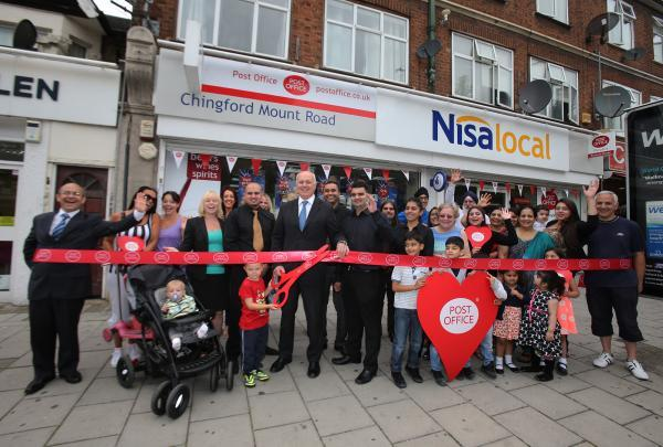 MP Iain Duncan-Smith cuts the red ribbon outside the Chingford Mount branch in Chingford Mount Road
