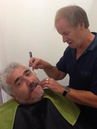 Ready with the razor: barber Michael Wood grooms Stephen Alambritis' beard