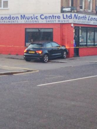 Police cordoned off the scene where the car hurtled into the shop