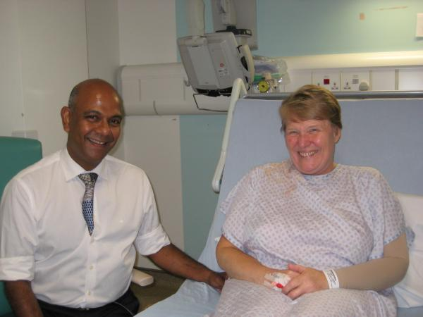 Prof Arnie Purushotham (surgeon) with patient Andrea Arney, the morning after her breast cancer surgery.