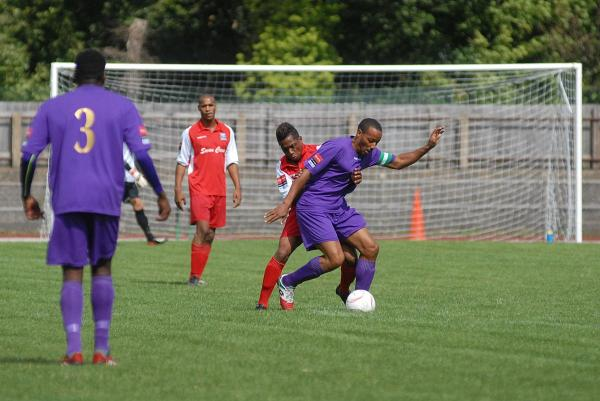 Midfield battle: Carshalton Athletic's Tony Sinclair in action during the Robins' first win of the season