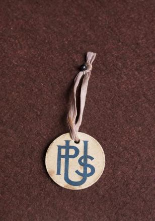 Blast From the Past: a cardboard badge worn by recruits from university and public schools