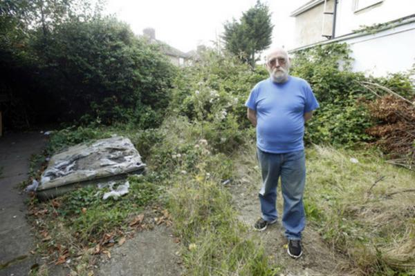 David Herrington, 65, never had his gate replaced by Enfield Homes and seen his garden become a jungle