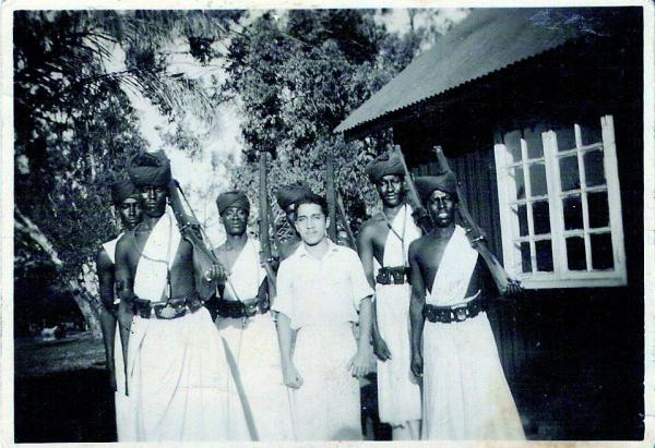 A young Mr Maciel with tribal police in Kenya
