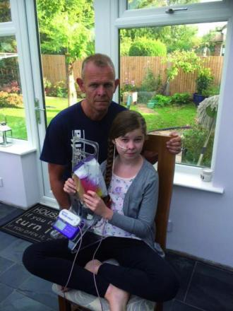 James Dobbe with his daughter Lauren, whose condition means she has to be fed through a tube