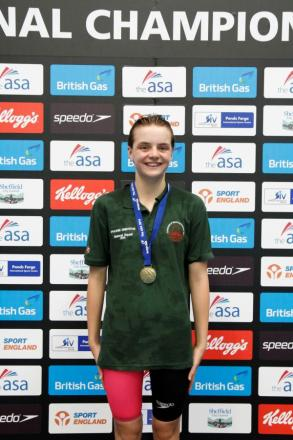 Phoebe Griffiths poses with one of her medals at the Age Group National Championship.