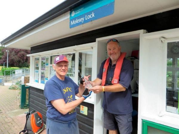 Handover: John Roscoe from Dittons Skiff Club accepting the bottle fro