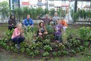 Former Blue Peter gardener Chris Collins working with local children to regenerate Peter Pan's Park earlier this year.