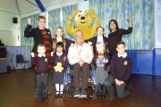 Rob Groves and Pudsey with staff and pupils from Days Lane Primary School