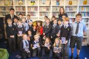 Caroline Lawrence and Bishop Gilpin pupils at the launch of the new school library