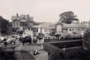 Tommy Cotching owned the farm at Hangar Lane, Ealing. The cows passing through the gate are heading towards what is today's North Circular Road. The large house in the background, called Hotspur Lodge, survives till this day. The photograph was taken sh