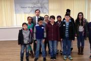 Headteacher Hakan Gokce with pupils at North London Grammar School