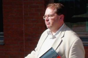 On-the-run vicar jailed for church fees thefts