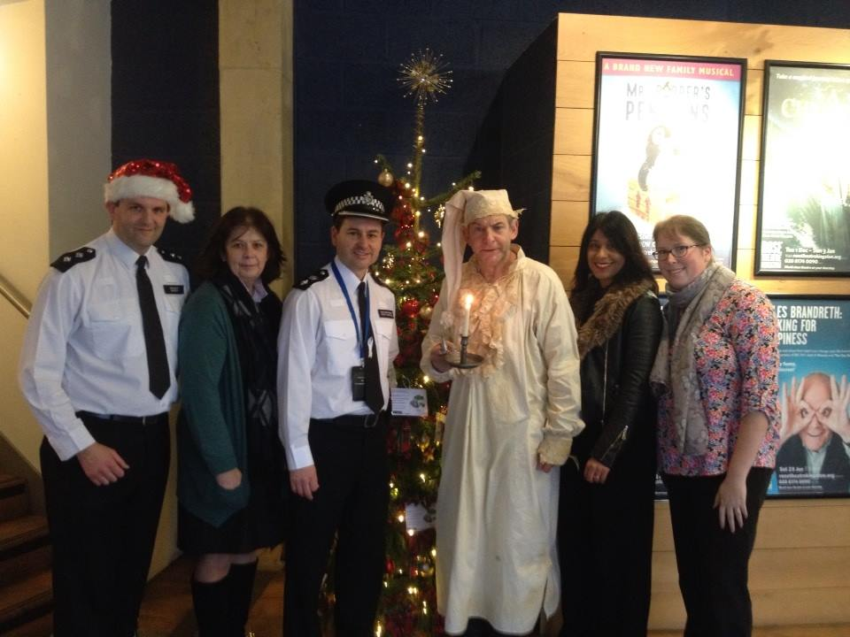Officers from Kingston police pose with charity Grow Baby's Noni Farrelly and Martin Ball's Scrooge from the Rose Theatre's upcoming production of A Christmas Carol