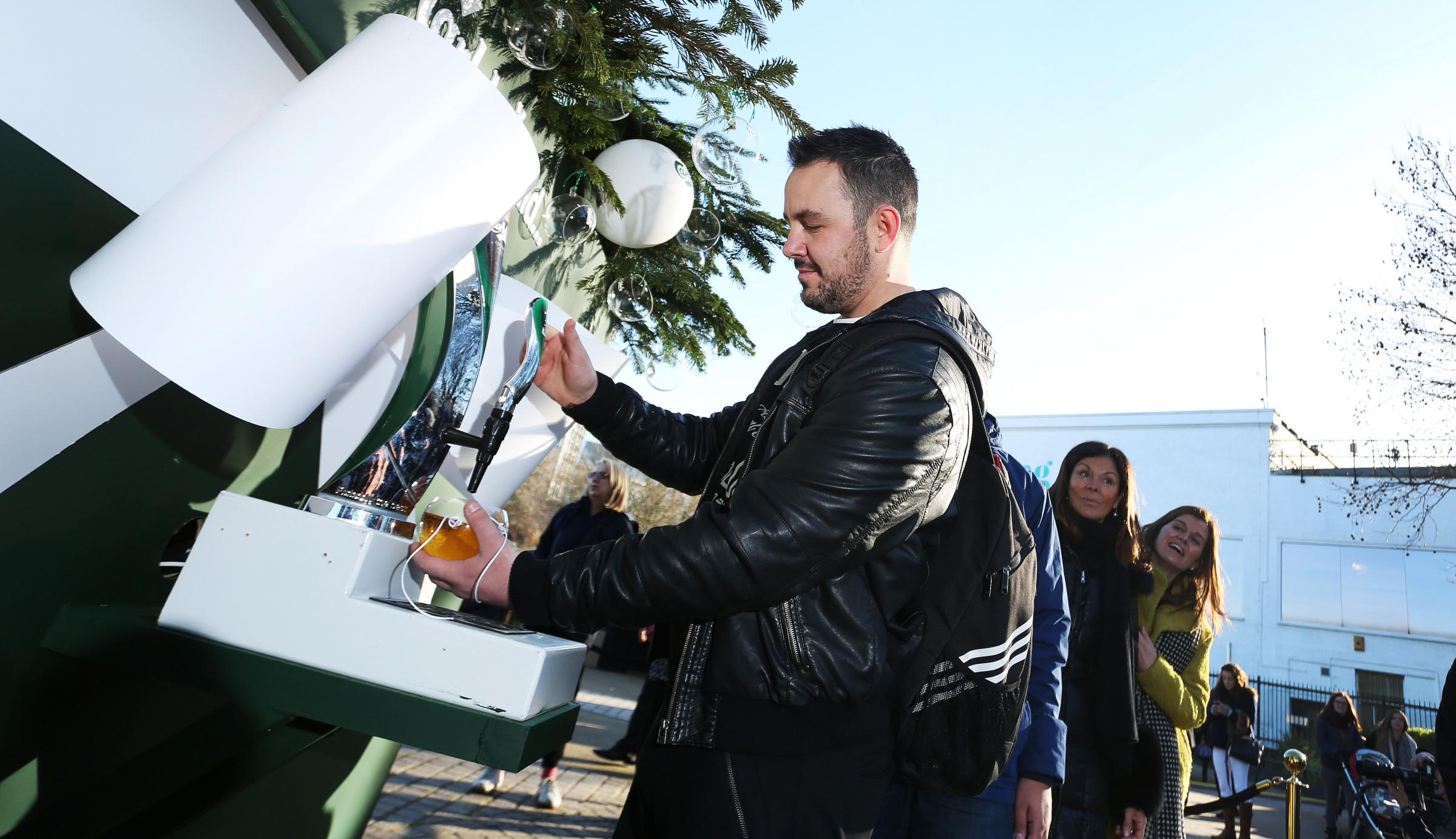 Carlsberg's Christmas tree on London's Southbank was dispensing free beer to passers-by