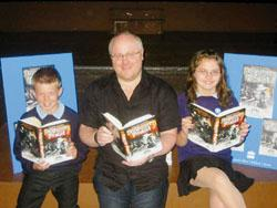 This Is Local London: BOOKWORMS: Derek Landy enjoys his new book with Lewis Cochrane and Kirsty Harrison, aged 12.