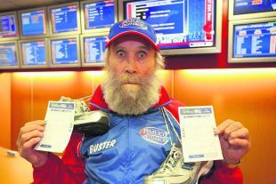 Buster Martin, with the two betting slips which could land the Rhys Daniels Trust a £13,300 windfall