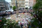In pictures: Crowd sings Don't Look Back In Anger after silence for bomb victims