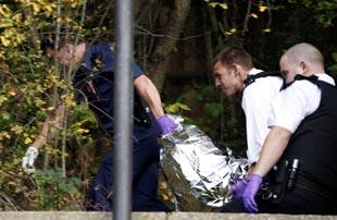 Police remove Asbo's body after the shooting