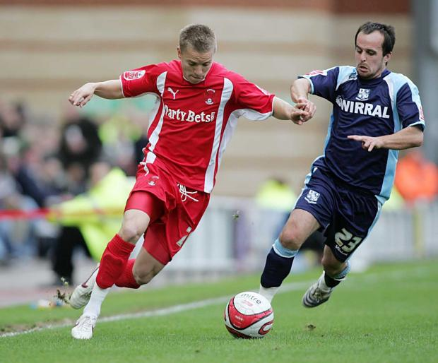 Jason Demetriou looks to get the better of Rovers scorer Chris Shuker
