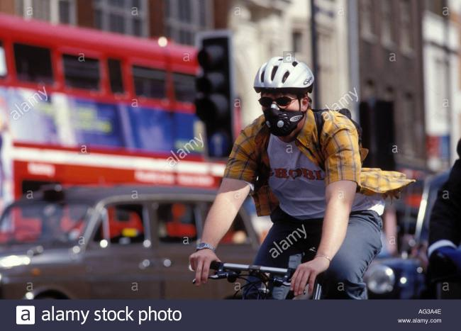 London Cyclists use masks so they do not inhale harmful chemicals. Credit: Alamy stock photo.(Royalty Free)