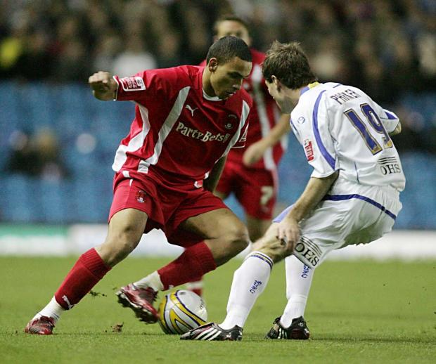 Orient's Dean Morgan looks to find a way past Leeds' Ben Parker